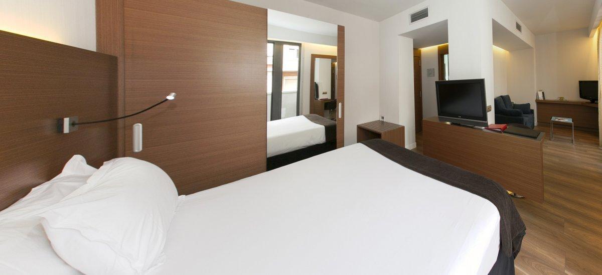 Habitaciones hotel vincci zaragoza zentro web oficial for Habitaciones zaragoza